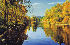 A smooth river in fall surrounded by trees in fall foliage
