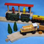 A toy train and tracks made from wood