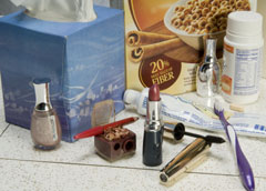 Everyday items containing wood: lipstick, toothpaste, cereal, toys and vitamins