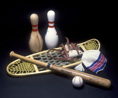 Sporting products made from wood: bowling pins,snowshoes,baseball bat and ball, hat