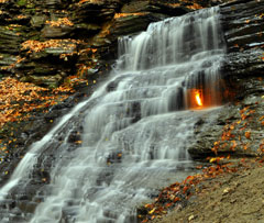 A waterfall with a flame, fueled by natural methane gas escaping from a fissure in the rock