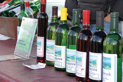 A selection of local wines displayed at a farmer's market