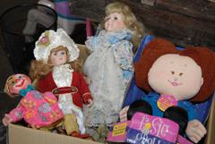 A selection of dolls at a consignment shop