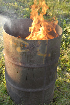 A burn barrel on fire