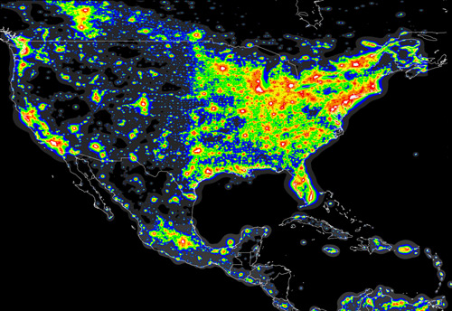 A sattelite image of the USA at night showing nighttime illumination