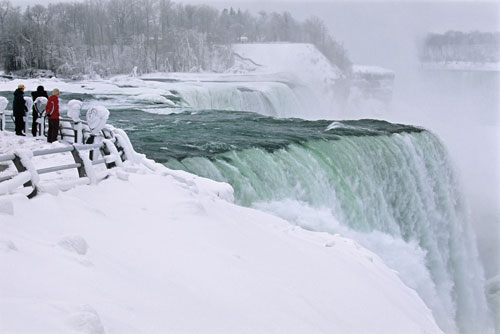 People viewing Niagara falls in winter
