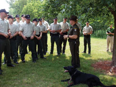An ECO instructs new recruits about working with dogs in the K9 unit.