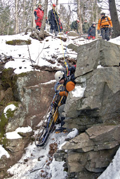 ECOs conduct practice search and rescue operations in the winter on a rocky cliff