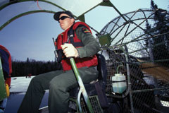 A forest ranger in an air boat