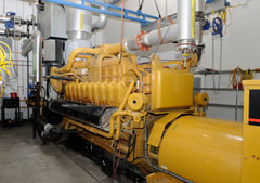 Yellow-colored machinery inside a gas-to-energy facility