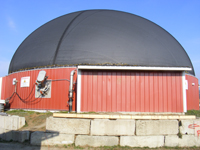 brick red with black roofed anaerobic digester