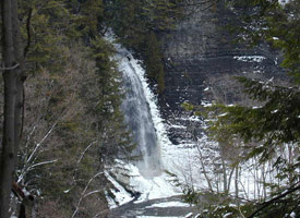 A flowing waterfall in winter at Barnes Corners