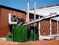 Green biomass heat exchanger with pipes outside brown building