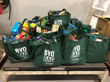 BYOBagNY reusable bags filled with food donations