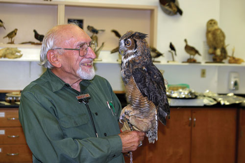 wildlife rehabilitator with an owl