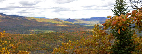 A photo of mountains showing fall colors