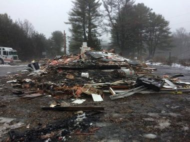 Large pile of charred building debris