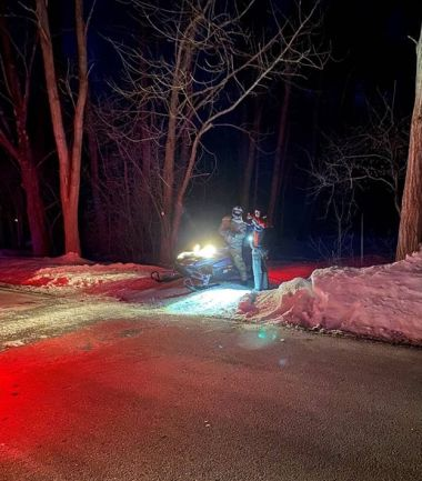 Snowmobiler stopping at checkpoint at night