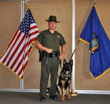 ECO poses for photo with K9 partner