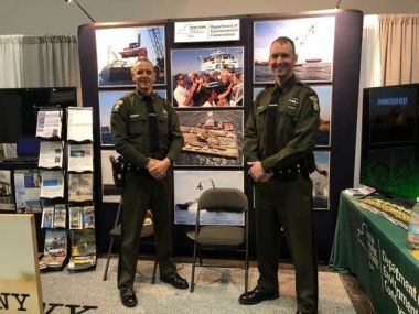Two ECOs pose for a picture at the NY Boat Expo DEC booth
