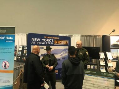 Two ECOs speak with interested boaters at the NY Boat Expo