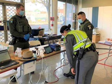 ECO monitors fit test for State Trooper