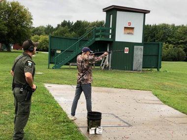 ECO supervising a youth hunter at a gun range