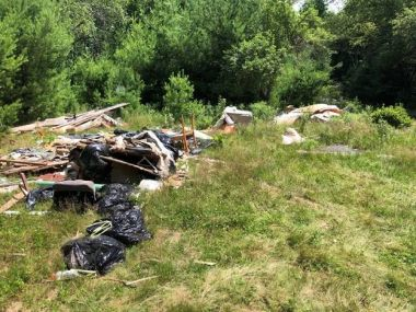large piles of debris and garbage in a field