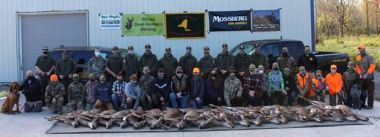 Group photo of youth hunters and ECOs with their bounties