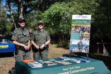 Two ECOs at an informational booth
