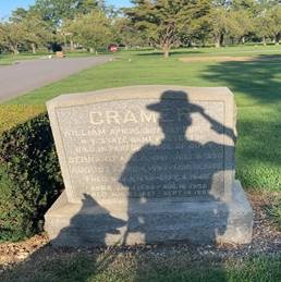 Shadow of ECO and K9 reflected onto ECO Cramer's headstone