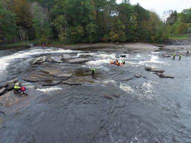 Training team in creek