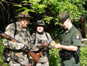 ECO checking hunting licenses
