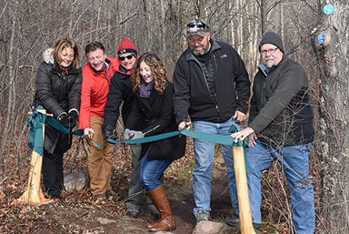 ribbon cutting at elm ridge wild forest trails