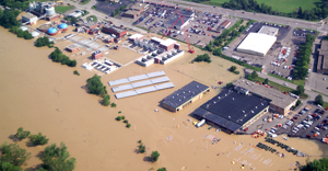Aerial view of flooded buildings and parking lot