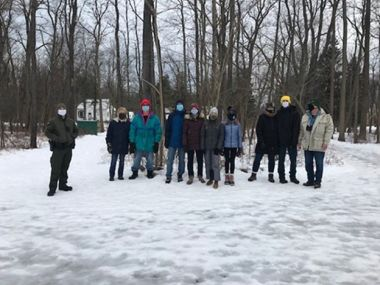 Group of hikers pose for a group photo after their First Day Hike