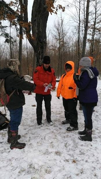 Forest Ranger gives directions to hikers on their First Day Hike