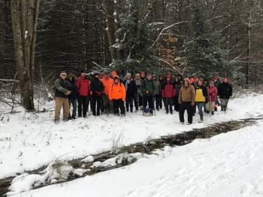 Hikers pose for a group photo during their First Day Hike
