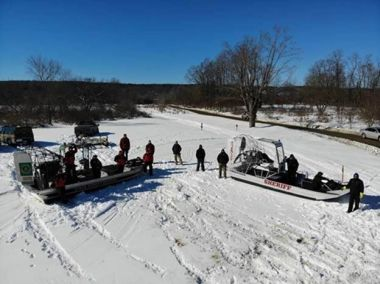 Aerial view of Forest Rangers and Sheriffs with airboats