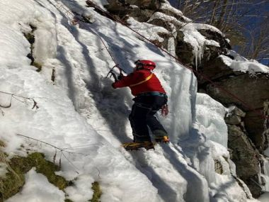 Forest Ranger climbing steep, icy terrain