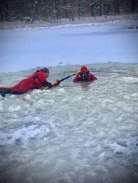 Two Forest Rangers practice flat ice rescue techniques
