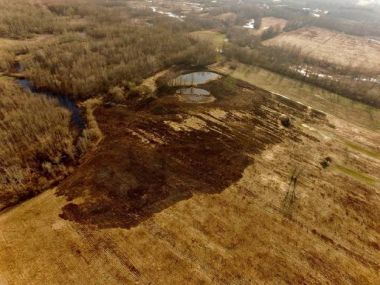 aerial view of grassland that has been burned in a wildfire