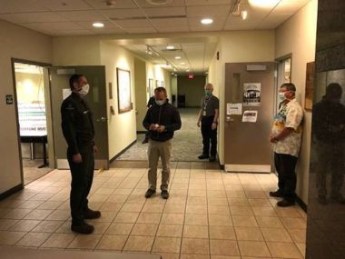 Forest Ranger stands in a hallway awaiting Commissioner to adhere his Captain bars