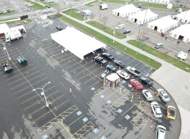 Aerial view of a parking lot that has been converted to a COVID testing site