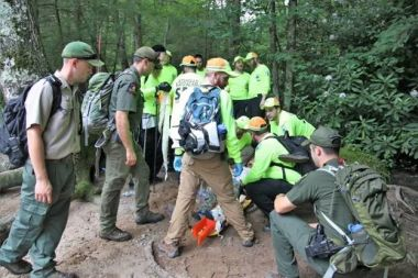 Forest Rangers and local emergency response learn training in the woods