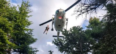 Rescued hiker dangling from helicopter after rescue