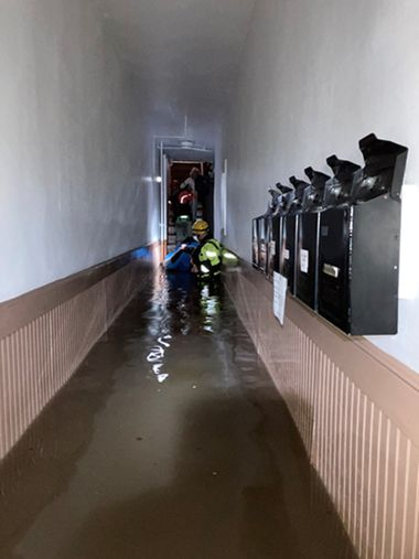 Rangers moving down long, flooded hallway to rescue residents