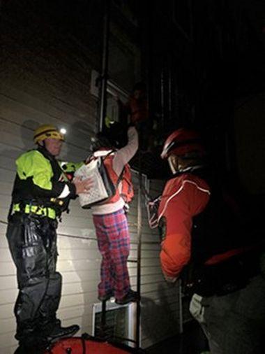 Rangers helping flood victim down fire escape