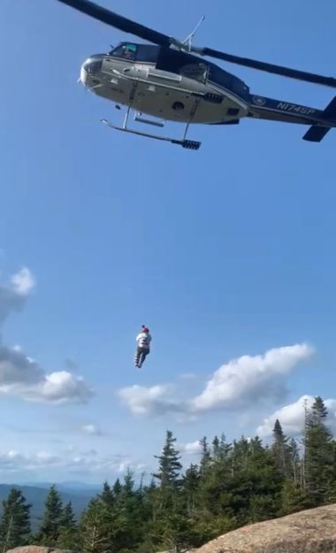 Helicopter lifts hiker up and out of woods