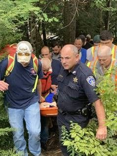 Kayaker being carried out of woods